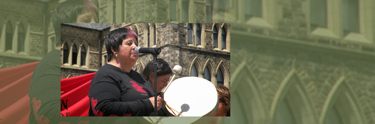 Latest News - Sharon beating drum in front of Parliament Building in Ottawa