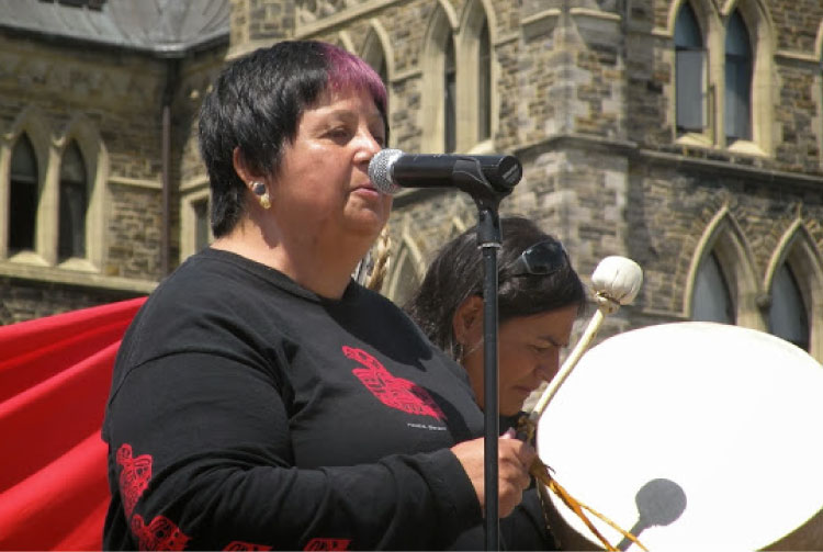 Sharon McIvor Drumming in front of Parliament Building, Ottawa